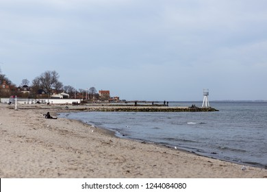 Klampenborg, Denmark - March 25, 2017:  People at one of the iconic lifeguard towers at Bellevue Beach just North of Copenhagen