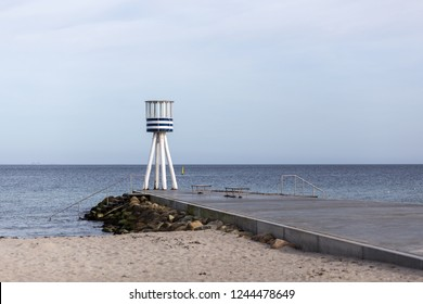 Klampenborg, Denmark - March 25, 2017: Blue and white stripped lifeguard tower at Bellevue Beach