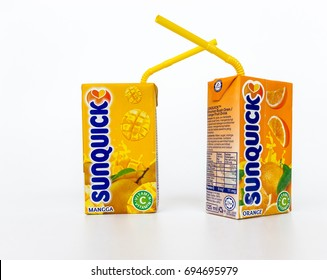 Klang , Malaysia - 10 August 2017 : Sunquick liquid in box packaging flavor mango/orange isolated white background. Sunquick is a product of CO-RO A/S a Danish company.
