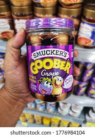 Klang, Malaysia - 10 July 2020 : Hand hold a jar of SMUCKER'S Goober Grape for sell in the supermarket with selective focus.