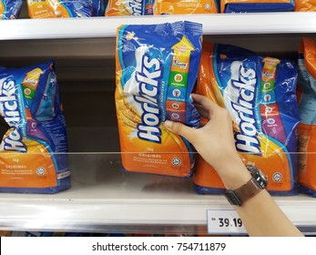 Klang , Malaysia - 12 November 2017 : Hand picks up a Horlicks melted milk powdered form packet in the supermarket.