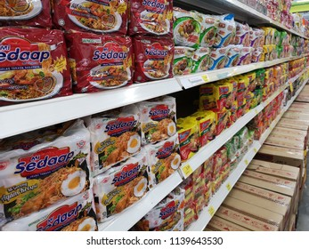 Klang, Malaysia - 13 July 2018 : Assorted a packet of branded instant noodles display for sell in the supermarket shelf.
