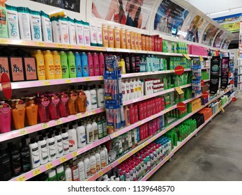 Klang, Malaysia - 13 July 2018 : Various type of branded health care shampoo display for sell in the supermarket shelf.