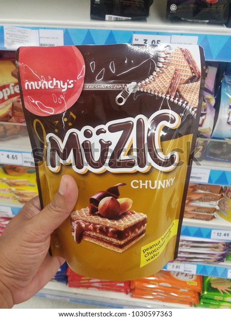 fa60362b4 Klang , Malaysia - 15 February 2018 : Hand hold a packet of MUNCHY'S Music  wafer