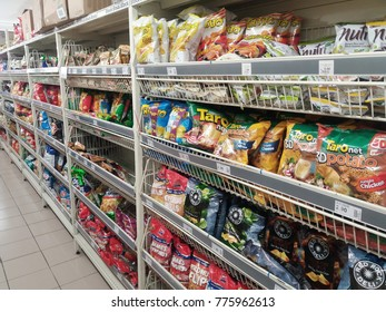 Klang , Malaysia - 15th December 2017 : Line or row a various packets snack display on the shelves in supermarket.