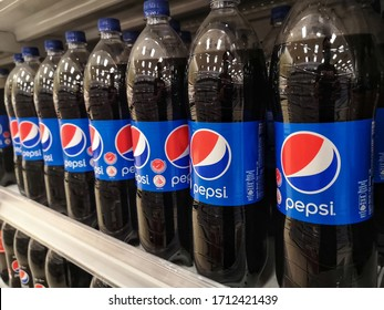 Klang, Malaysia - 19 April 2020 : Close up a Pepsi drinks in the bottle in the supermarket shelf. Pepsi is a carbonated soft drink that is produced and manufactured by PepsiCo.