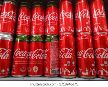 Klang, Malaysia - 26 April 2020 : Assorted a Coca Cola can drinks on display in a grocery store. Coca Cola Company is leading manufacturer of soda drinks in the world.