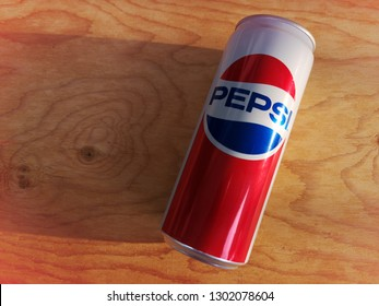 Klang, Malaysia - 27 January 2019 : Pepsi carbonated soft drink aluminium can on the wooden background.Pepsi is a carbonated soft drink that is produced and manufactured by PepsiCo