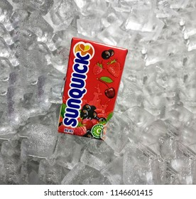 Klang, Malaysia - 30 July 2018 : Sunquick liquid fruit juice box flavor Berries in ice crushed. Sunquick is a product of CO-RO A/S a Danish company.