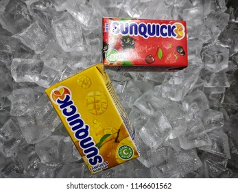 Klang, Malaysia - 30 July 2018 : Sunquick liquid fruit juice box flavor Berries and Mango in ice crushed. Sunquick is a product of CO-RO A/S a Danish company.