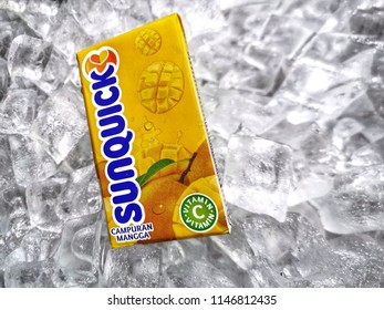 Klang, Malaysia - 30 July 2018 : Sunquick liquid fruit juice box flavor Mango in ice crushed. Sunquick is a product of CO-RO A/S a Danish company.