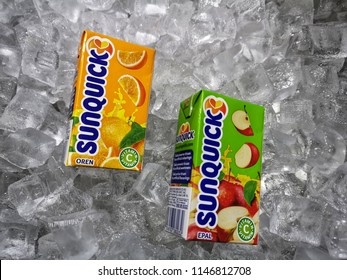 Klang, Malaysia - 30 July 2018 : Sunquick liquid fruit juice box flavor Apple and Orange in ice crushed. Sunquick is a product of CO-RO A/S a Danish company.