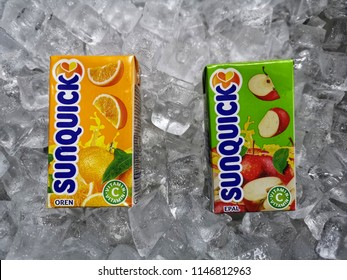 Klang, Malaysia - 30 July 2018 : Sunquick liquid fruit juice box flavor Orange and Apple in ice crushed. Sunquick is a product of CO-RO A/S a Danish company.