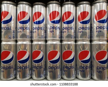 Klang , Malaysia - 30 May 2018 : PEPSI Light cans display for sell in the supermarket shelf.Pepsi is a carbonated soft drink that is produced and manufactured by PepsiCo.Mobile photoghpy.