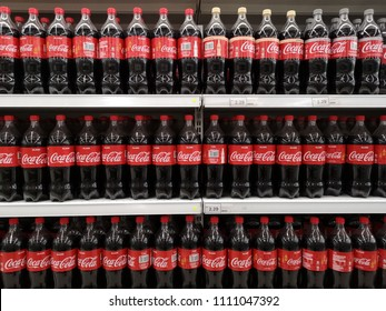 Klang , Malaysia - 30 May 2018 : Coca Cola brand soft drink on display for sell at a supermarket shelf in Penang. Coca Cola is a famous soft drink maker.