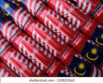 Klang, Malaysia - 4 October 2018 : Upclose a carbonated soft drink cans of COCA-COLA Classic new design for Independent Day of Malaysia season.Coca Cola is a famous soft drink maker.