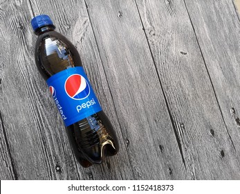 Klang, Malaysia - 5 August 2018 : Pepsi carbonated soft drink plastic bottle on the wooden background.Pepsi is a carbonated soft drink that is produced and manufactured by PepsiCo.