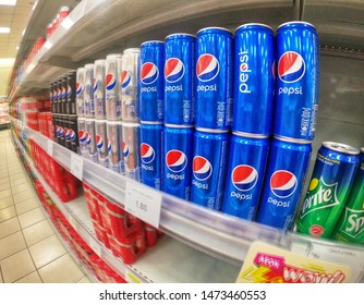 Klang, Malaysia - 5 August 2019 : Pepsi drinks cans on the supermarket shelves with selective focus. Pepsi is a carbonated soft drink that is produced and manufactured by PepsiCo.
