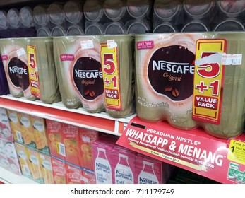 Klang , Malaysia - 7 September 2017 : Nescafe original is a brand name of milk coffee low fat drink cans on the shelf in supermarket