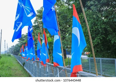 Klang Malaysia Apr 25, 2018. Party flags put up to advocate support during campaigning for the coming Malaysian Election, flags tied to railings by the road side