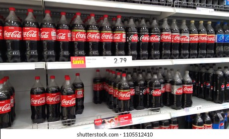 Klang, Malaysia - June 2, 2018 : Coca-cola in bottles on row display for sale in the supermarket shelves. Coca-Cola is a carbonated soft drink produced by The Coca-Cola Company.