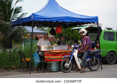 Klang, Malaysia - June 2nd, 2018 : Food vendor and crowd of people at open bazar. Open bazar is popular among Malaysian to buy food especially before iftar, Ramadan celebrating.