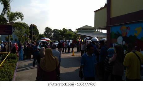 KLANG, MALAYSIA, May 9, 2018 : People lining up in the morning to vote during the general election in Klang, Malaysia. underexposed