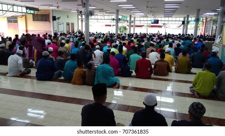 Klang, Malaysia - September 1,2017 : male Muslims  performing the Jummah prayer on Friday in Klang, Malaysia. underexposed