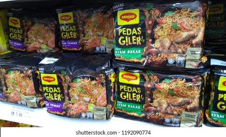 KLANG, MALAYSIA - SEPTEMBER 28, 2018: Mee goreng segera Maggi Pedas Giler perisa Tom Yummz dan Ayam Bakar. Maggi Crazy Spicy Tomyam and Grill Chicken flavor.