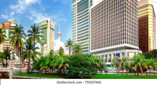 Klang River and Mosque Jamek among modern buildings in Kuala Lumpur, Malaysia
