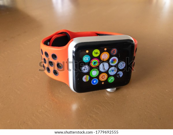 Klang, Selangor, Malaysia: 20th July 2020- View of an apple watch sport on a wooden table. Modern watch