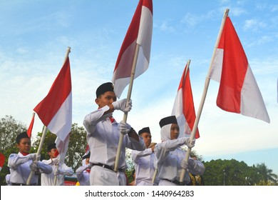 Klaten Indonesia.  August 17th 2017.  Indonesian students bring red white flags in ceremony celebrating Independence Day.