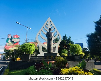 KLATEN, INDONESIA - MARCH 17, 2019 : Statue with traditional Javanese clothing (Patung Blangkon) at the morning in Klaten in Jawa Tengah in Indonesia. It is statue icon in Klaten.