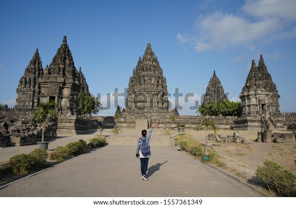 Klaten / Indonesia - Oct 31 2019 : An asian tourist stand in front of Prambanan. Prambanan is a large Hindu temple. This temple located in Klaten, Indonesia