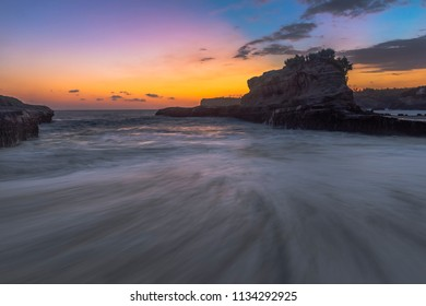Klayar beach in long exposure shot and golden hours, East Java, Indonesia; May 2018