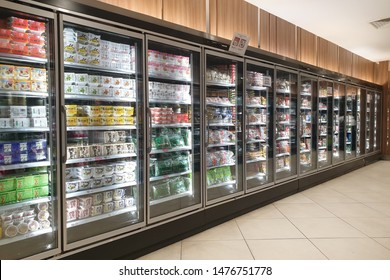 KLCC, MALAYSIA - JULY 27, 2019: Interior view of huge glass freezer with various brand beverage and food in Isetan store. Isetan is a Japanese department store throughout Japan and South East Asia.
