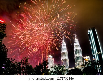 KLCC Park, Kuala Lumpur, Malaysia - January 1, 2019: Fireworks display at the klcc park marks the beginning of new year 2019. Multiple firework shots were blasted into the air litting up the sky.