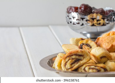 Klecha Iraqi Date Cookies with Dates in the Background with Copy Space Horizontal