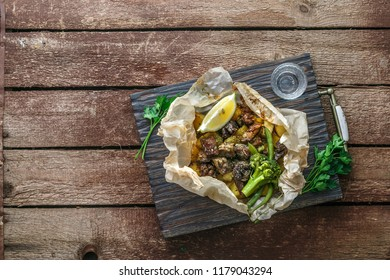 Kleftiko slowly cooked lamb with vegetables and feta cheese. Traditional Greek dish. Copy space