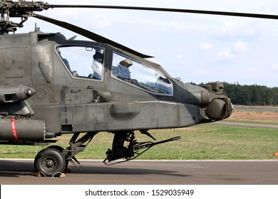 Kleine Brogel, Belgium - SEP 08, 2018: closeup of the front side of a Boeing AH-64 Apache from the Dutch air force at Kleine Brogel, Belgium. Belgium air force days.