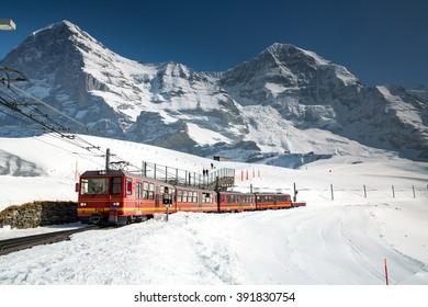 Kleine Scheidegg, Switzerland - March 13, 2016: View of a Jungfrau Railways train, connecting Kleine Scheidegg to Jungfraujoch.