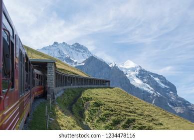 Kleine Scheidegg/Switzerland - August 26 2015: The landscape from the windows of a wagon of the train to Jungfraujoch, Switzerland. Jungfraujoch is the highest railway station in Europe.