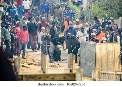 Kleinmond, Western Cape, South Africa, September 11th 2017. With a crown gathering, violent protesters prepare petrol bombs to hurl at police during illegal protest action and riots.