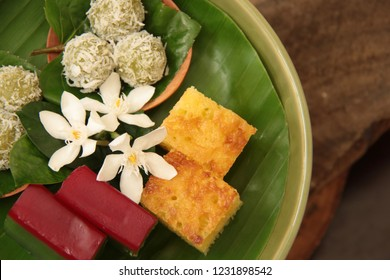 Klepon, Bika Ambon, Kue Lapis. Traditional Indonesian cakes of glutinous rice balls, tapioca sponge cake, and tapioca layer cake.