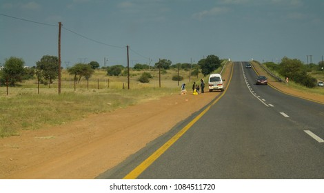 Klerksdorp, North West Province/South Africa - May 01 2018: Taxi transporting, dropping off African people in the rural area with blue sky and a high way road
