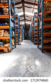 Klerksdorp, South Africa - February 17, 2015: Interior of empty industrial parts distribution warehouse shelves