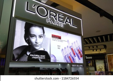 KLIA, MALAYSIA - APR 22, 2018: Loreal cosmetic products advertisement display board in KLIA Airport, Malaysia. L'Oréal is world's largest cosmetics company in France.