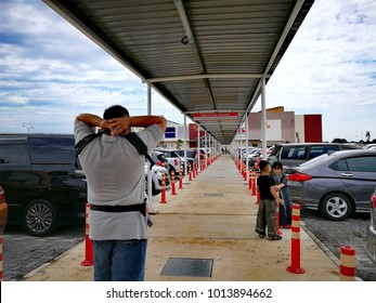 KLIA, Malaysia - January 28, 2018: Covered walkaway in the parking area outside the Mitsui Outlet Park, Sepang.