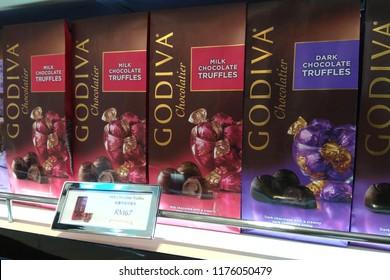 KLIA, MALAYSIA - JUNE 24, 2018: GODIVA Chocolate gift box display on the shelf in KLIA2 Airport. GODIVA Chocolatier is a Belgian manufacturer of premium fine chocolates and related products.