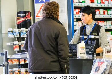 Klimovsk, Moscow region, Russsia - October, 16, 2017: salesman in the car components shop in Klimovsk, Russia